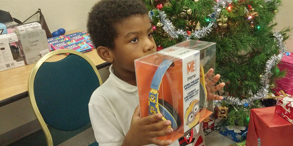 Angels Provide Christmas Gifts for Village Oaks Kids