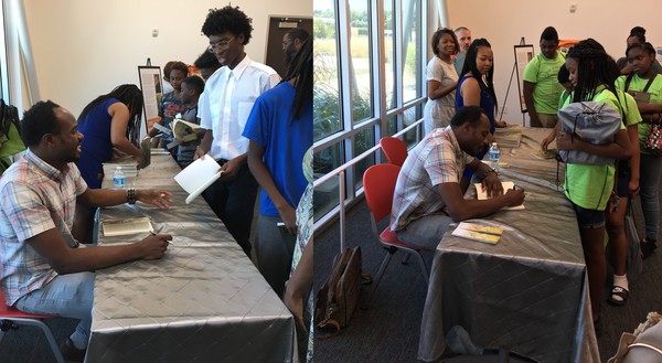 Acclaimed Poet, Author Jamaal May Polishes Pearls of Wisdom