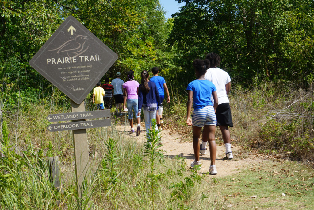 Students on a trail at Trinity River Audubon Center.