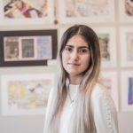 Teenage girl in front of paintings