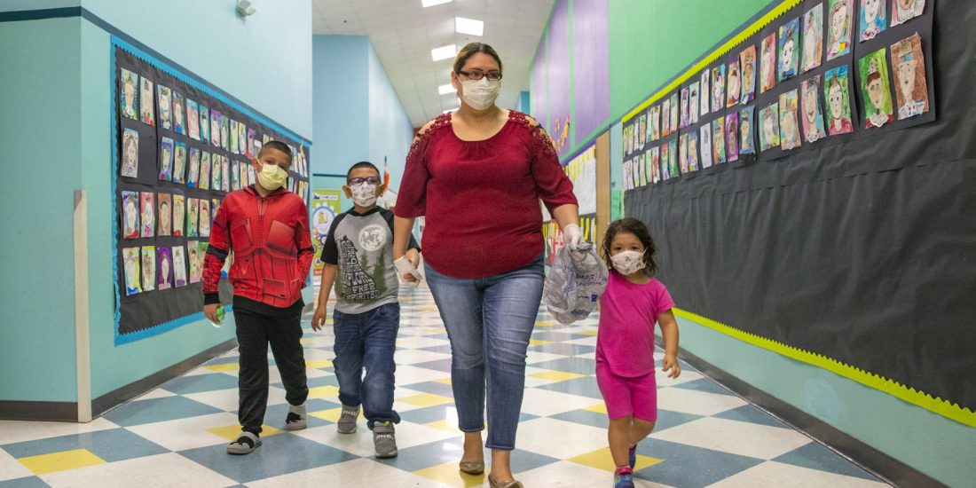 Mom with kids in facemasks