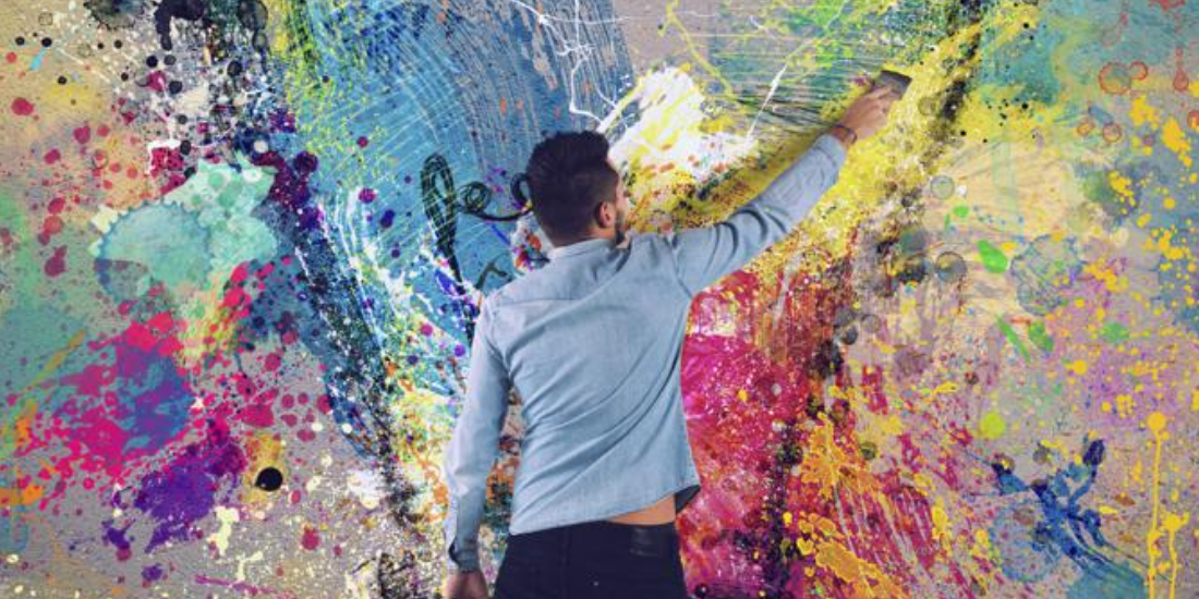 Man painting on wall with chalk