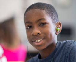 Middle School Student with earbuds