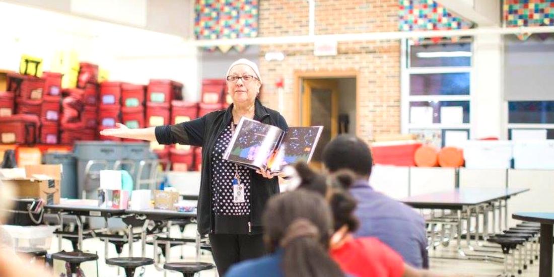 Mary Hernandez reading to students
